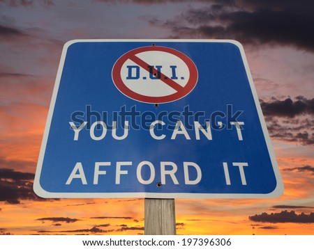 DUI you can't afford it warning sign with sunset sky. - stock photo