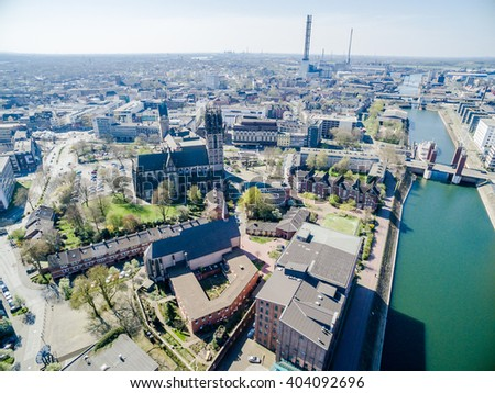 DUISBURG / GERMANY - APRIL 11 2016 : The city with Salvator church under the sun, aerial