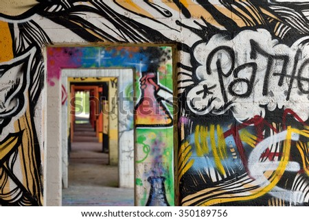 DUISBURG, GERMANY - October 26: Graffiti in Rheinpark Duisburg on October 26, 2015 in Duisburg, Germany. Duisburg hosts a comprehensive range of cultural facilities and events.