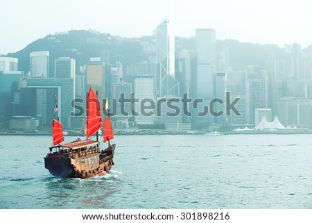 Duk Ling Ride, Hong Kong harbour with tourist junk - stock photo