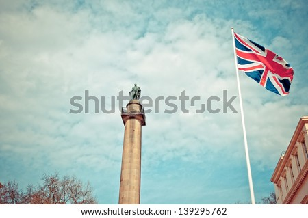 Duke of York Column in London next to Union Jack, Great Britain flag - stock photo