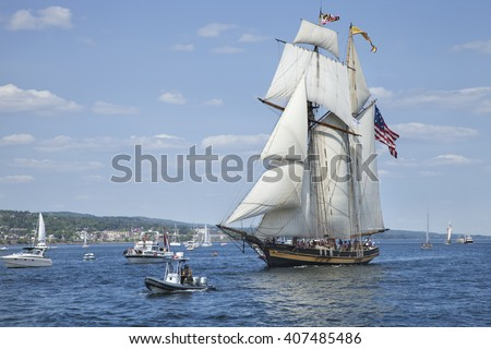 DULUTH, MINNESOTA, USA - JULY 29, 2010: The Pride of Baltimore II, a replica of an 1812-era Baltimore Clipper privateer, enters Duluth harbor on Lake Superior during the Tall Ships festival. - stock photo