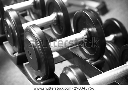 dumbbell in gym with filter black and white - stock photo