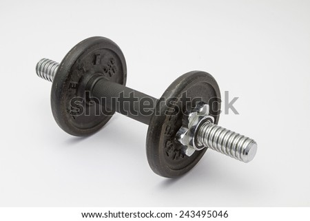 Dumbbell on white background - stock photo
