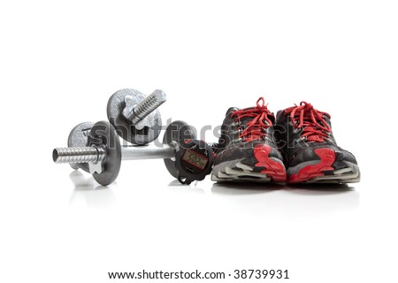Dumbbells and tennis shoes on a white background - stock photo