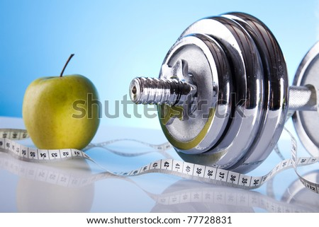 Dumbbells, Fitness and measure tape - stock photo