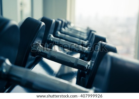 Dumbbells in modern gym fitness center - Selective focus and color tone effect