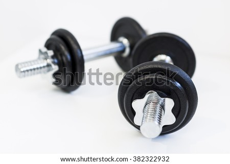 Dumbbells on a white background. - stock photo