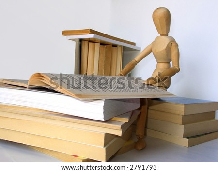 dummy and books - stock photo