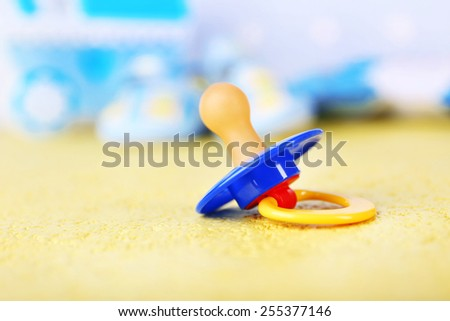 Dummy for baby, close-up, on bright background - stock photo