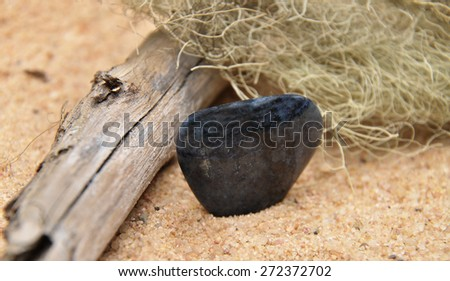 Dumortierite on beach - stock photo