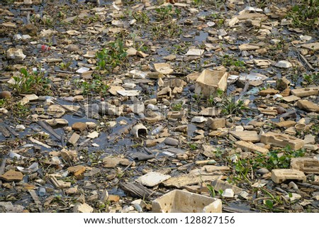 Dump. polluted green water, puddle garbage in Saigon, Vietnam. - stock photo
