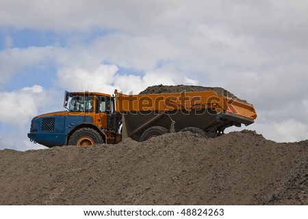 Dump-truck fully loaded - stock photo