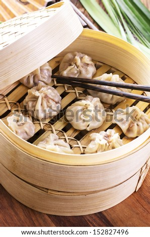 dumplings in bamboos steamer - stock photo