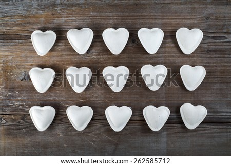 Dumplings in the form of hearts on a dark wooden background. Top view. - stock photo