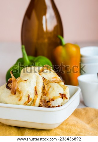 dumplings with fried onions and sour cream, Ukrainian cuisine on a white background - stock photo