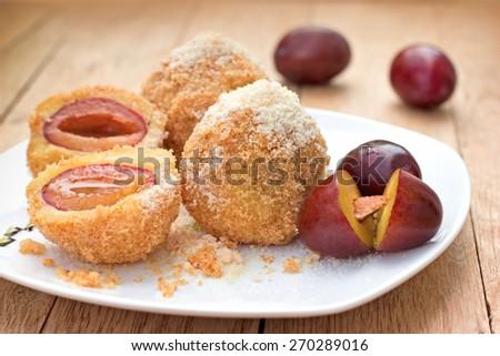 Dumplings with plums - sweet pleasure, sweet treat - stock photo