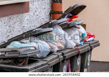 dumpster waste management, symbol of garbage, garbage disposal, throw-away society - stock photo