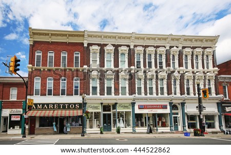 DUNDAS, CANADA - JUNE 28, 2016:  Shops on the main street through Dundas. Dundas is a formerly independent town but now part of the city of Hamilton, Ontario, Canada. - stock photo