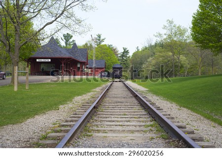 DUNDAS,CANADA-May 9,2015: Dundas Conservation area Trail Centre, a victorian reproduction of a an old railway station built in 1929 the train car was donated by the Canadian Pacific Railway in 1978. - stock photo