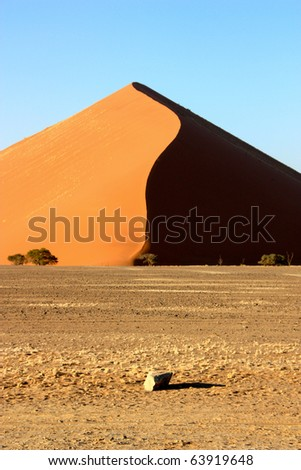Dune and little stone - stock photo