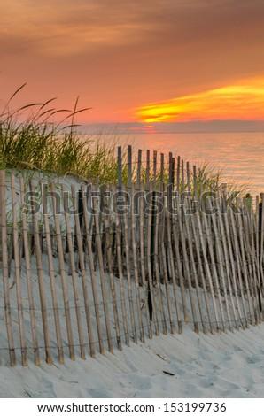 Dune at sunset - stock photo