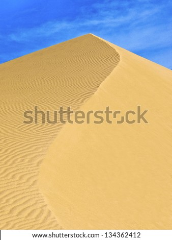Dune in the Deserts of western Egypt with �S� shaped curve along ridge. - stock photo