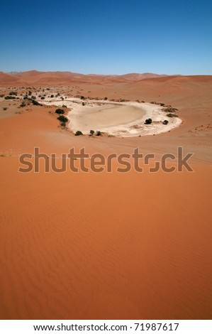 Dune sea of the Namib desert during a hot day - stock photo