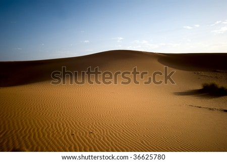 Dunes of Sahara desert during the sunset, Morocco - stock photo