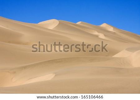 Dunes of the Namib desert, outside Walvis Bay, Namibia. - stock photo
