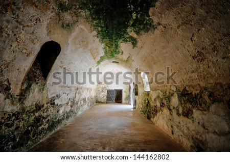 Dungeon were male slaves were kept prior to transshipment. Elmina Castle (also called the Castle of St. George) is located on the Atlantic coast of Ghana west of the capital, Accra. - stock photo