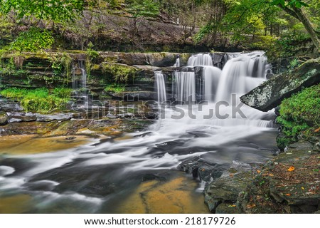 Dunloup Falls on Dunloup Creek is a beautiful West Virginia waterfall about two miles from the New River and the old railroad town of Thurmond. - stock photo