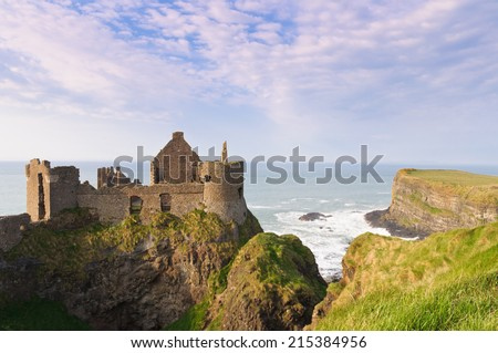 Dunluce castle on the northern coast of County Antrim, Northern Ireland. - stock photo