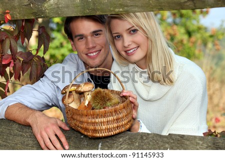 duo behind a hedge - stock photo