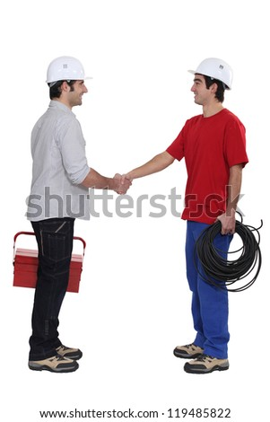 duo of electrician shaking hands - stock photo