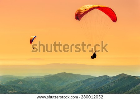 Duo paragliding flight - stock photo