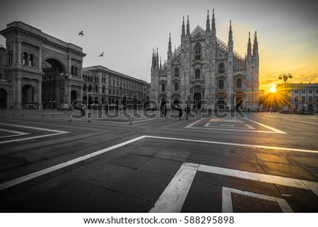 Duomo cathedral in black and white with yellow sun flare milan italy