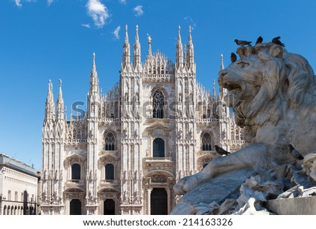 Duomo cathedral of Milan, Italy. with the lion statue. - stock photo