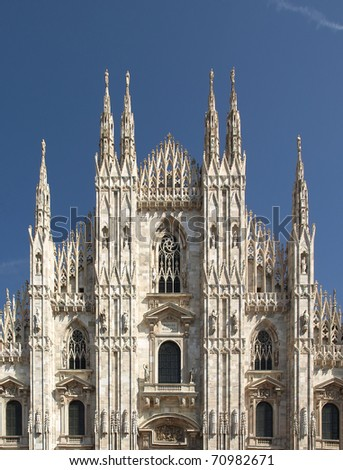 Duomo di Milano, Milan gothic cathedral church - rectilinear frontal view - stock photo