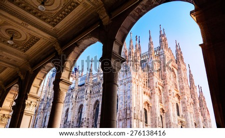 Duomo of Milan, Italy. Cathedral. Symbol of Milano.Beautiful sunset. Looking up from arcade.  - stock photo