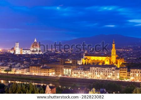Duomo Santa Maria Del Fiore and Basilica di Santa Croce at twilight from Piazzale Michelangelo in Florence, Tuscany, Italy - stock photo