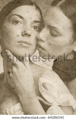 Duotone portrait of two beautiful slim sexy young girls in corsets on vintage damaged grainy background - stock photo
