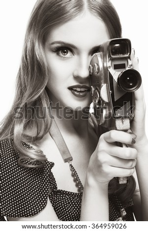 Duotone portrait of young beautiful girl with vintage camera  - stock photo