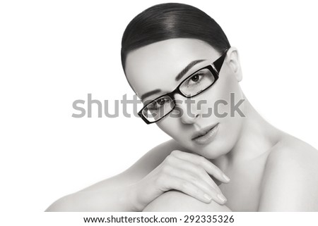 Duotone portrait of young beautiful woman in stylish glasses over white background