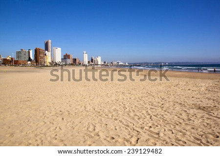 "DURBAN, SOUTH AFRICA - DECEMBER 18, 2014: Many unknown people on Addington Beach against ""Golden Mile"" city skyline in Durban, South Africa"