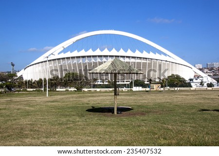 DURBAN, SOUTH AFRICA - DECEMBER 4, 2014:  Viewing Moses Mabhida stadium from grass recreational area on Beach front  in Durban, South Africa