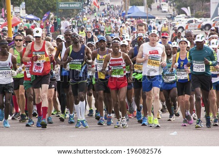 DURBAN, SOUTH AFRICA - JUNE 1, 2014: Crowd of runners competing in the long distance Comrades Marathon between Pietermaritzburg and Durban in South Africa.  - stock photo