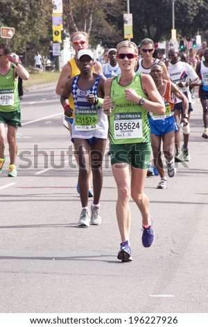 DURBAN, SOUTH AFRICA - JUNE 1, 2014: Runners competing in the long distance Comrades Ultra Marathon between Pietermaritzburg and Durban in South Africa.