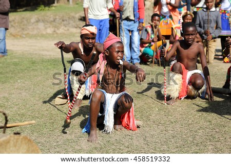 DURBAN, SOUTH AFRICA - June 4: Traditional dancers including a young child perform at a wedding ceremony in Kwa Zulu Natal, South Africa on June 4, 2016.
