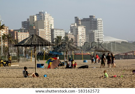 DURBAN, SOUTH AFRICA - MARCH 22, 2014: Many people and children on  North Beach Beachfront in Durban South Africa.